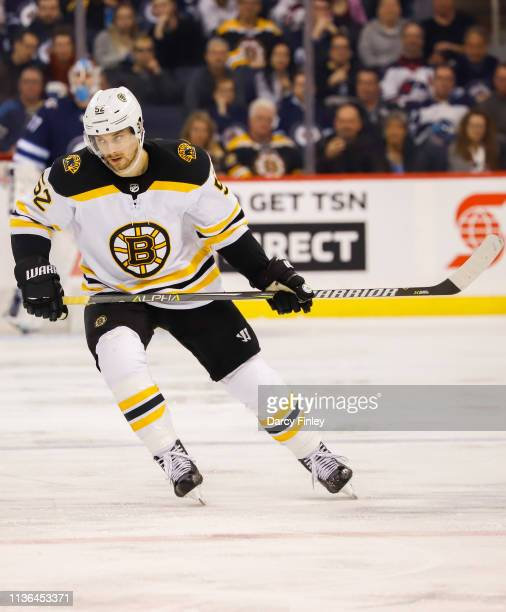 Sean Kuraly of the Boston Bruins follows the play down the ice during second period action against the Winnipeg Jets at the Bell MTS Place on March...