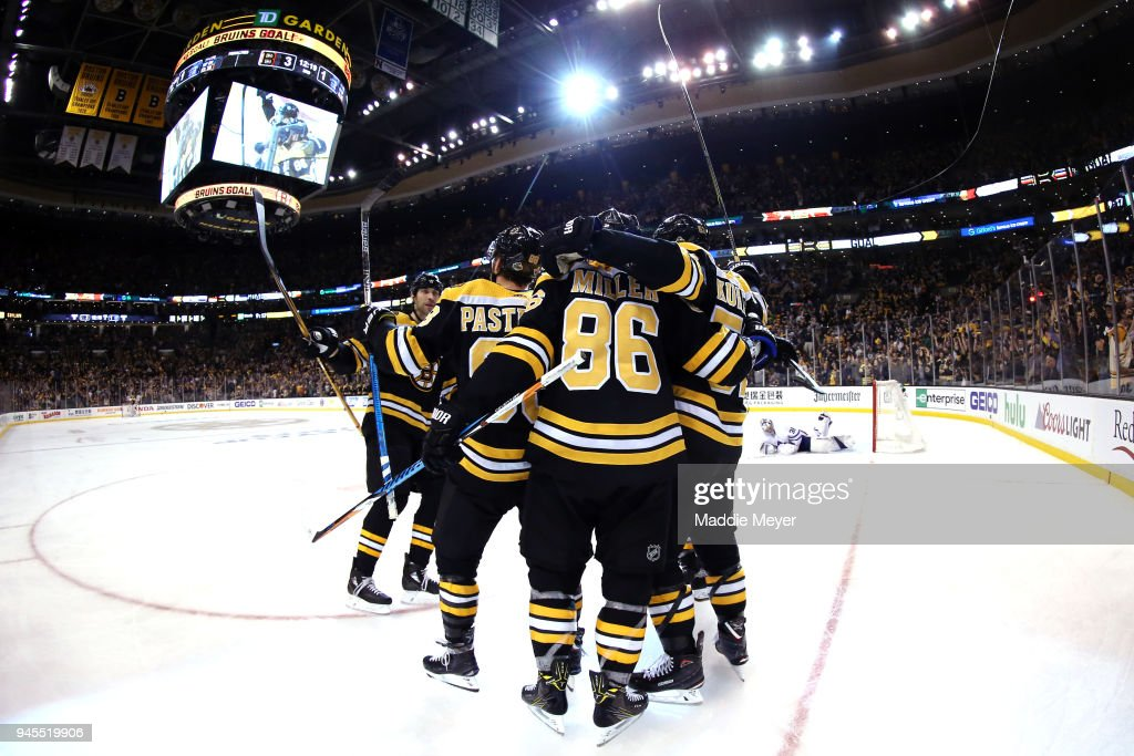 Sean Kuraly #52 of the Boston Bruins, right, celebrates with Kevan Miller #86, David Pastrnak #88 and Zdeno Chara #33 after scoring a goal against the Toronto Maple Leafs during the third period of Game One of the Eastern Conference First Round during the 2018 NHL Stanley Cup Playoffs at TD Garden on April 12, 2018 in Boston, Massachusetts. The Bruins defeat the Leafs 5-1.