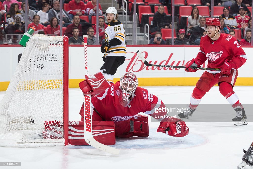 Sean Kuraly #52 of the Boston Bruins (not pictured) scores a second period goal on Jimmy Howard #35 of the Detroit Red Wings as teammate Nick Jensen #3 looks for the rebound during an NHL game at Little Caesars Arena on February 6, 2018 in Detroit, Michigan. The Bruins defeated the Wings 3-2.