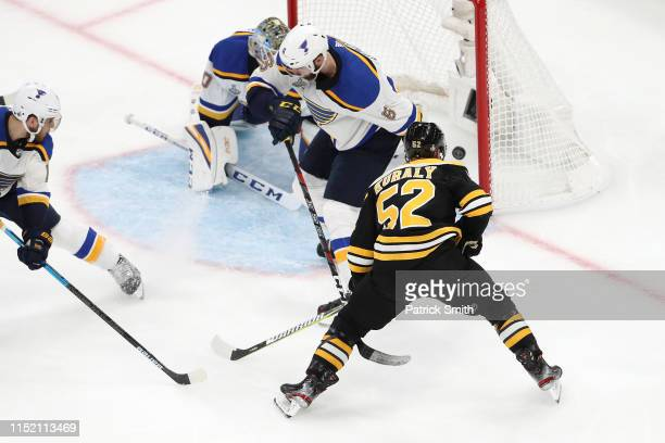 Sean Kuraly of the Boston Bruins scores a third period goal past Jordan Binnington of the St. Louis Blues in Game One of the 2019 NHL Stanley Cup...