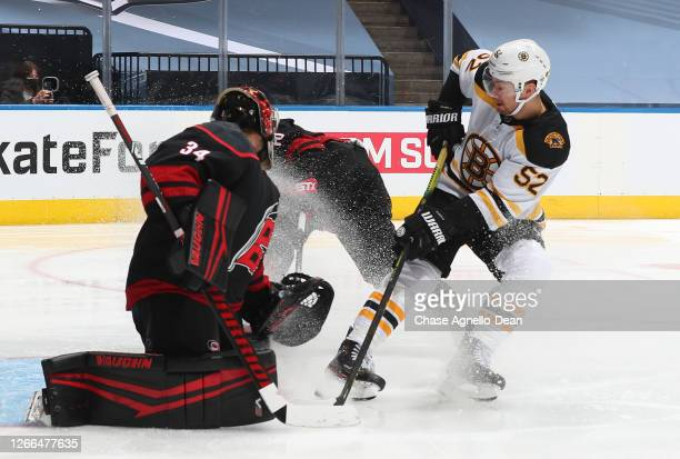 Sean Kuraly of the Boston Bruins scores on a tip in against goaltender Petr Mrazek of the Carolina Hurricanes in the third period of Game Three of...