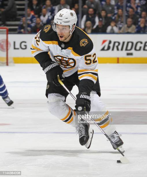 Sean Kuraly of the Boston Bruins skates with the puck against the Toronto Maple Leafs in Game Six of the Eastern Conference First Round during the...