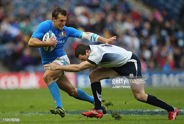 Sean Lamont of Scotland tackles Alberto Sgarbi of Italy during the RBS Six Nations match between Scotland and Italy at Murrayfield on March 19 2011...