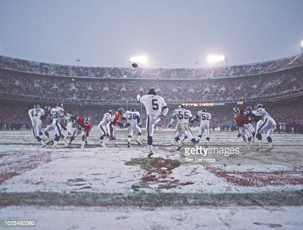 Sean Landeta Punt Kicker for the New York Giants kicks the ball upfield during the National Football Conference game in the snow against the Denver...