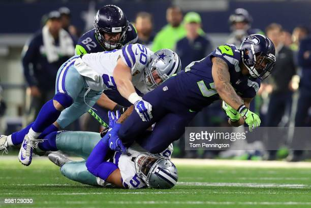 Sean Lee of the Dallas Cowboys and Damien Wilson of the Dallas Cowboys combine to tackle Thomas Rawls of the Seattle Seahawks in the second quarter...