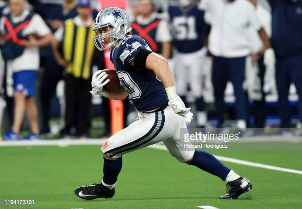 Sean Lee of the Dallas Cowboys carries the ball after an interception against the Los Angeles Rams in the second quarter at AT&T Stadium on December...