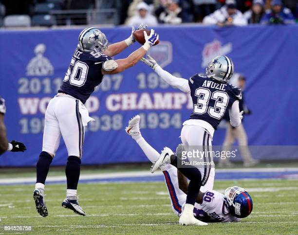 Sean Lee of the Dallas Cowboys intercepts a pass meant for Darius Powe of the New York Giants in an NFL football game on December 10, 2017 at MetLife...