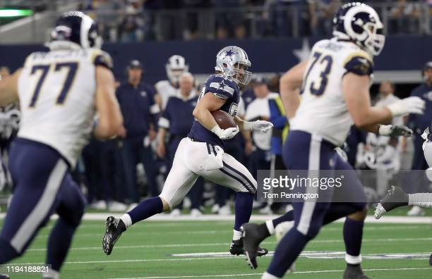 Sean Lee of the Dallas Cowboys returns an interception against the Los Angeles Rams in the second half at AT&T Stadium on December 15, 2019 in...