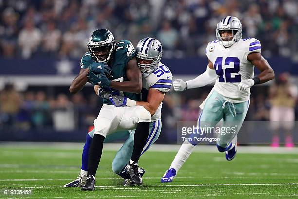 Sean Lee of the Dallas Cowboys tackles Nelson Agholor of the Philadelphia Eagles during a game between the Dallas Cowboys and the Philadelphia Eagles...