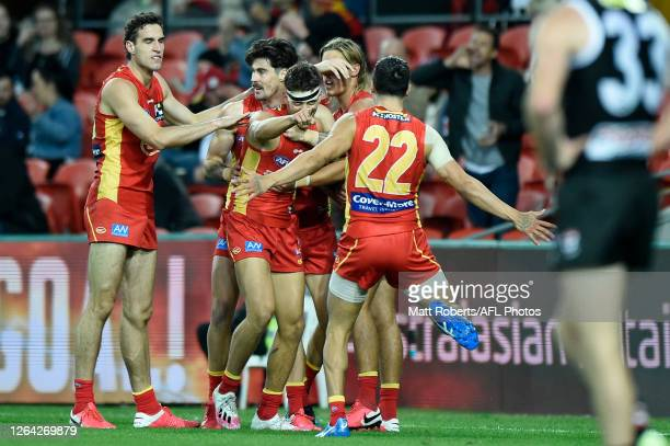 Sean Lemmens of Gold Coast Suns celebrates kicking a goal during the round 10 AFL match between the Gold Coast Suns and the St Kilda Saints at...