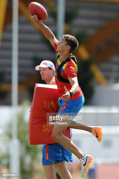 Sean Lemmens punches the ball during a Gold Coast Suns AFL training session at Metricon Stadium on April 8, 2014 on the Gold Coast, Australia.