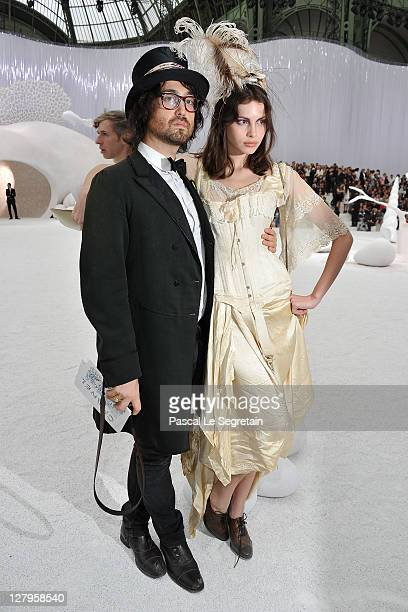 Sean Lennon and Charlotte Kemp Muhl attend the Chanel Ready to Wear Spring / Summer 2012 show during Paris Fashion Week at Grand Palais on October 4...
