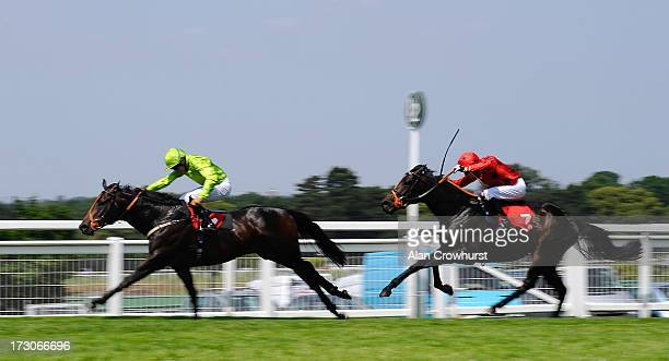 Sean Levey riding Beach Club win The Malcolm Palmer Memorial Handicap Stakes at Sandown racecourse on July 06 2013 in Esher England