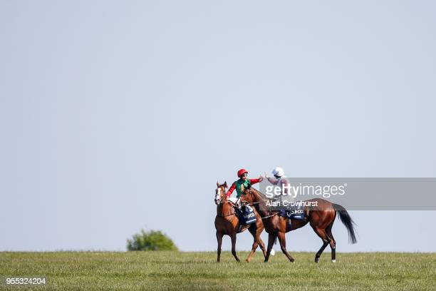 Sean Levey riding Billesdon Brook are congratulated by PJ McDonald after winning The Qipco 1000 Guineas Stakes at Newmarket Racecourse on May 6 2018...