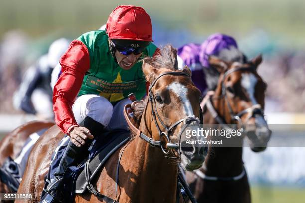 Sean Levey riding Billesdon Brook celebrate winning The Qipco 1000 Guineas Stakes at Newmarket Racecourse on May 6 2018 in Newmarket United Kingdom