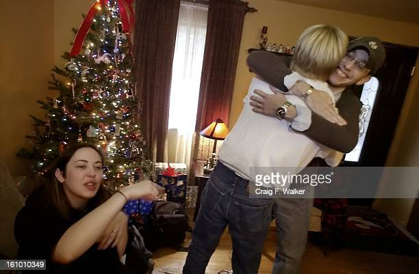 DECEMBER 18 2004 INDIANAPOLIS IN Sean Lewis and his father Paul Burton celebrate while watching a fooball game as his wife Jessica jokes at left They...