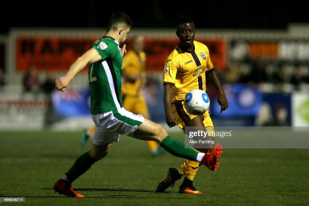 Sean Long of Lincoln City closes down Kieran Cadogan of Sutton United during the Vanarama National League match between Sutton United and Lincoln City at Gander Green Lane on March 28, 2017 in Sutton, Greater London.