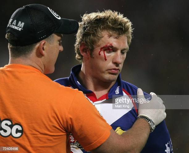 Sean Long of the Lions is attended to by a trainer after being hit by Willie Mason of the Kangaroos during the Tri-Nations Series match between the...