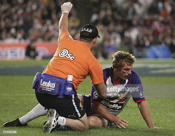Sean Long of the Lions lies injured after a late hit by Willie Mason of the Kangaroos during the TriNations Series match between the Australian...