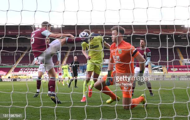 Sean Longstaff of Newcastle is challenged by James Tarkowski of Burnley, a challenge which went to VAR but no penalty was given during the Premier...