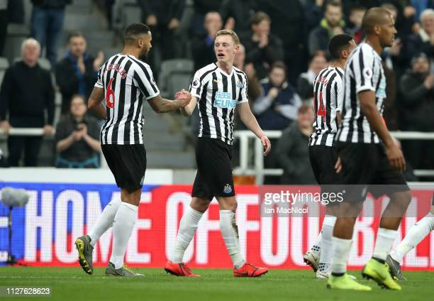 Sean Longstaff of Newcastle United celebrates after scoring his team's second goal with team mate Jamaal Lascelles during the Premier League match...