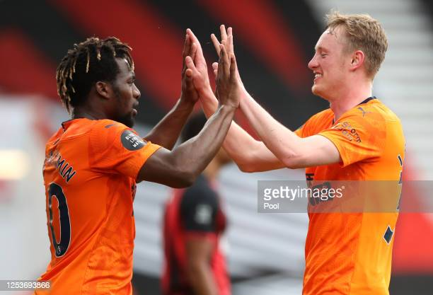 Sean Longstaff of Newcastle United celebrates after scoring his team's second goal with team mate Allan Saint-Maximin during the Premier League match...