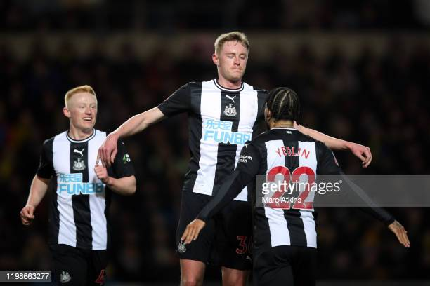 Sean Longstaff of Newcastle United celebrates scoring the opening goal with DeAndre Yedlin and Matthew Longstaff during the FA Cup Fourth Round...
