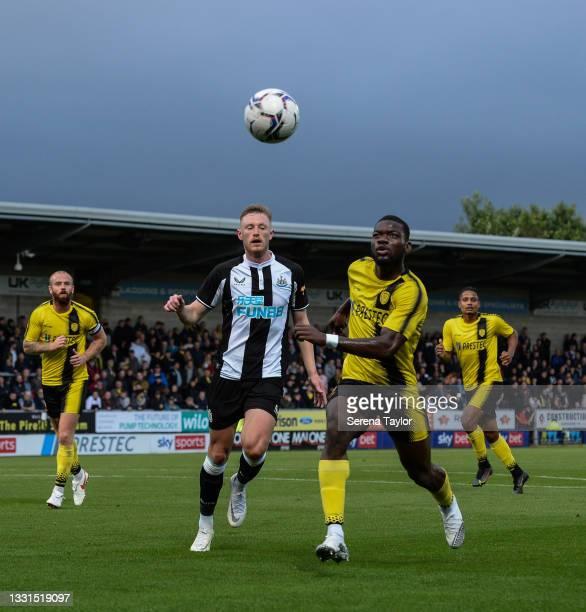 Sean Longstaff of Newcastle United FC and Adedeji Oshilaja of Burton Albion during the Pre Season Friendly between Burton Albion and Newcastle United...