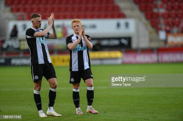 Sean Longstaff of Newcastle United FC and brother Matty Longstaff clap the fans during the Pre Season Friendly between Rotherham United and Newcastle...