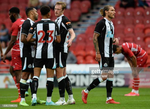 Sean Longstaff of Newcastle United FC celebrates with teammates after scoring the second goal during the Pre Season Friendly between Doncaster Rovers...