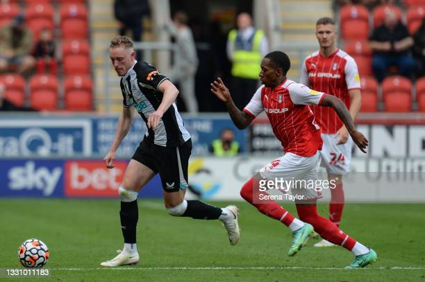 Sean Longstaff of Newcastle United FC runs with the ball as Mickel Miller of Rotherham United chases during the Pre Season Friendly between Rotherham...