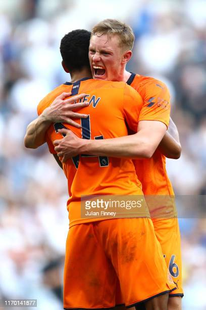 Sean Longstaff of Newcastle United hugs Isaac Hayden of Newcastle United after their sides victory in the Premier League match between Tottenham...