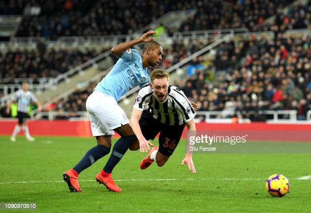 Sean Longstaff of Newcastle United is fouled by Fernandinho of Manchester City and a penalty is awarded during the Premier League match between...
