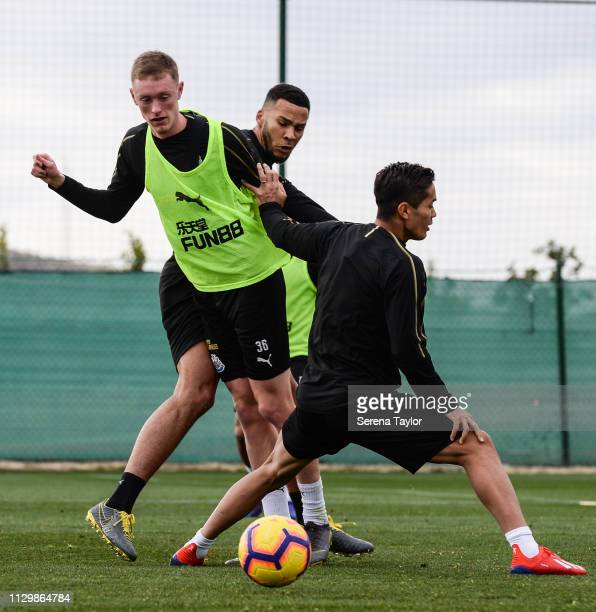 Sean Longstaff passes the ball whilst being challenged by Jamaal Lascelles and Yoshinori Muto during the Newcastle United Warm Weather Training...