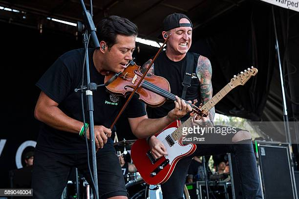 Sean Mackin and Ryan Key of Yellowcard perform at the Vans Warped Tour at White River Amphitheatre on August 12 2016 in Auburn Washington