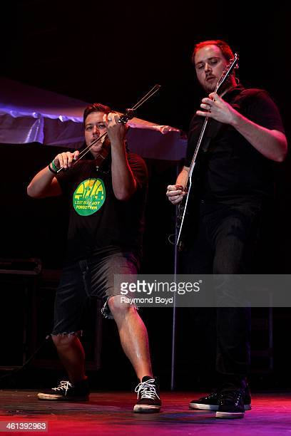 Sean Mackin and Ryan Mendez from Jacksonville Florida alternative rock band Yellowcard performs on the US Cellular Connection Stage at the Henry W...