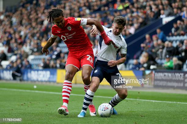 Sean Maguire of Preston North End and Toby Sibbick of Barnsley compete for the ball during the Sky Bet Championship match between Preston North End...