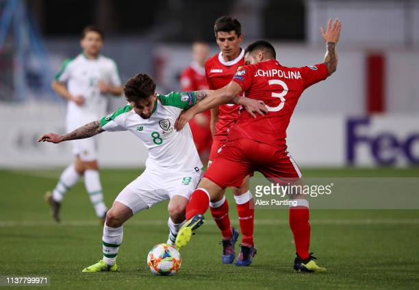 Sean Maguire of Republic of Ireland is challenged by Joseph Chipolina of Gibraltar during the 2020 UEFA European Championships group D qualifying...