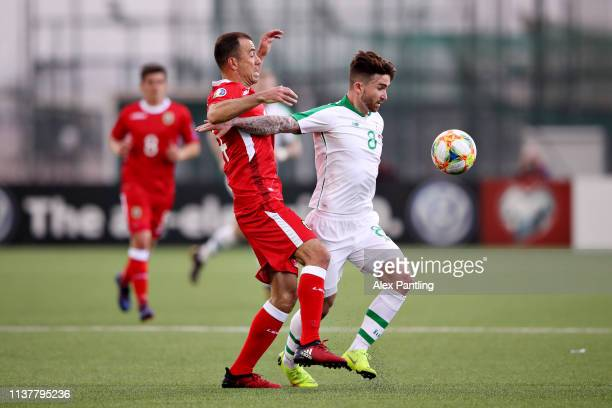 Sean Maguire of Republic of Ireland is challenged by Roy Chipolina of Gibraltar during the 2020 UEFA European Championships group D qualifying match...