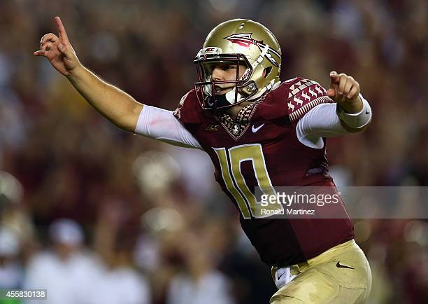 Sean Maguire of the Florida State Seminoles celebrates the overtime win against the Clemson Tigers at Doak Campbell Stadium on September 20 2014 in...