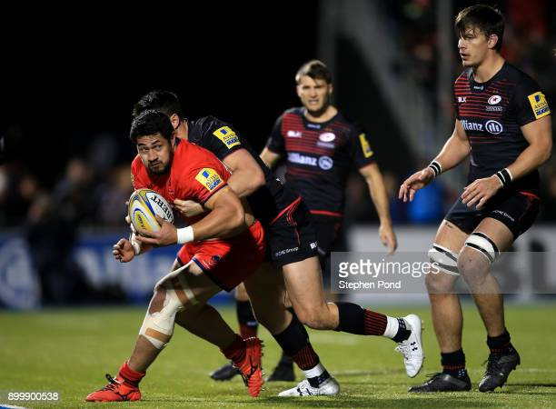 Sean Maitland of Saracens and Alafoti Faosiliva of Worcester Rugby compete for the ball during the Aviva Premiership match between Saracens and...