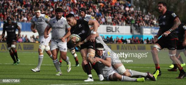 Sean Maitland of Saracens is tackled by Luke Charteris and Francois Louw during the Aviva Premiership match between Saracens and Bath at Allianz Park...