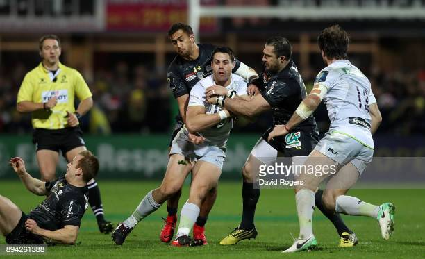Sean Maitland of Saracens is tackled by Peter Betham and Scott Spedding of Clermont during the European Rugby Champions Cup match between ASM...