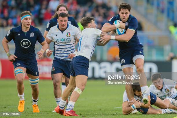 Sean Maitland of Scotland breaks a tackle during the 2020 Guinness Six Nations match between Italy and Scotland at Stadio Olimpico on February 22...