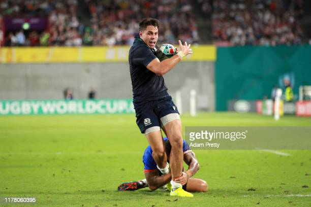 Sean Maitland of Scotland breaks through Tusi Pisi of Samoa to go on and score his team's first try during the Rugby World Cup 2019 Group A game...