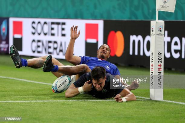 Sean Maitland of Scotland is tackled by Ed Fidow of Samoa during the Rugby World Cup 2019 Group A game between Scotland and Samoa at Kobe Misaki...