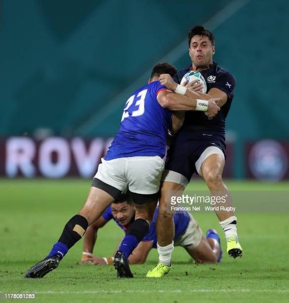 Sean Maitland of Scotland is tackled by Kieron Fonotia of Samoa during the Rugby World Cup 2019 Group A game between Scotland and Samoa at Kobe...