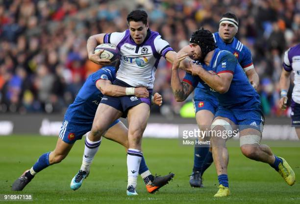 Sean Maitland of Scotland is tackled by Maxime Machenaud of France during the NatWest Six Nations match between Scotland and France at Murrayfield on...