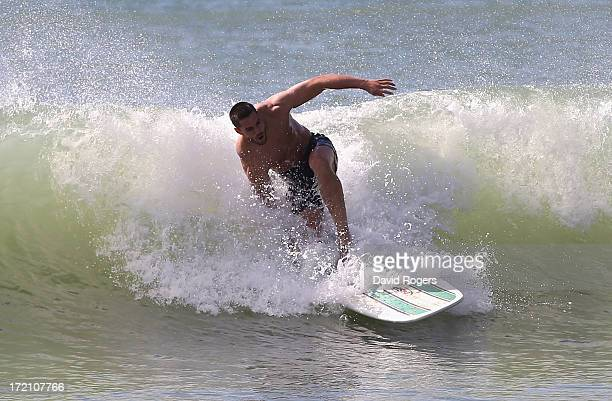 Sean Maitland of the British and Irish Lions rides a wave during surfing on July 2 2013 in Noosa Australia