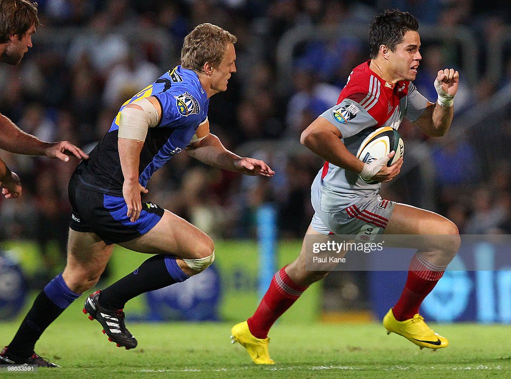 Sean Maitland of the Crusaders runs clear of Ryan Cross of the Force during the round 11 Super 14 match between the Western Force and the Crusaders at ME Bank Stadium on April 23, 2010 in Perth, Australia.